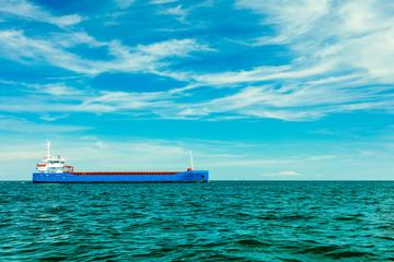 Industrial cargo vessel ship on sea waters