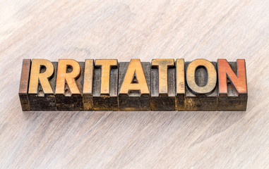 irritation word abstract in wood type