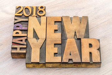 Happy New Year 2018 word abstract in wood type