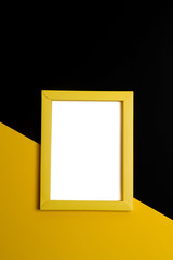 Empty yellow papper frame on colorful background with copy space.