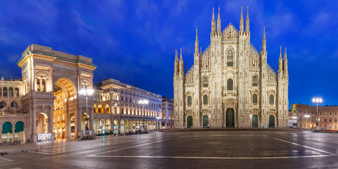 Panorama of the Piazza del Duomo, Cathedral Square, with Milan Cathedral or Duomo di Milano and Galleria Vittorio Emanuele II, during morning blue hour, Milan, Lombardia, Italy