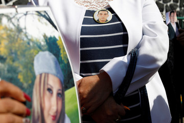 Pictures of missing persons are displayed during a protest outside Los Pinos presidential residence in Mexico City