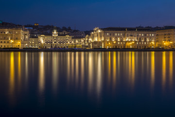 Buildings and Government palace on the waterfront of Trieste at night at Christmas time, Friuli Venezia Giulia, Italy