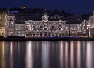 The Town Hall reflected on the waterfront of Trieste  at Christmas time, Friuli Venezia Giulia, Italy