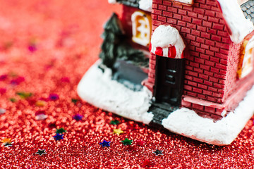 Winter decorative composition with small house and glitter