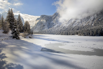 The Dobbiaco lake during a frozen winter, Pusteria valley, dolomites, Italy