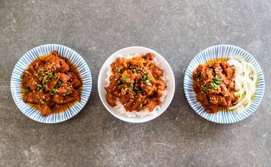 fried pork with spicy korean sauce (bulgogi) on top rice
