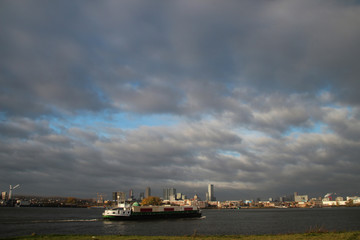 Wide angle view of dark sky above the Rotterdam skyline