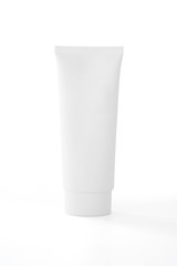 White cosmetic tube pack of cream or gel isolated on white background .