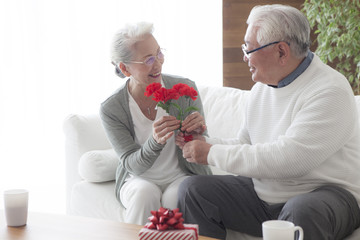 An old couple passing gifts