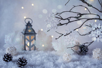 Frosty winter wonderland with snowfall and magic lights.  Christmas greetings concept