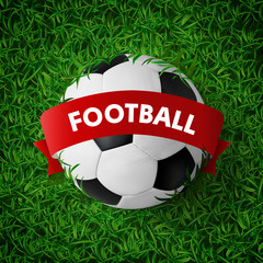 Realistic Soccer ball with red ribbon banner on green grass