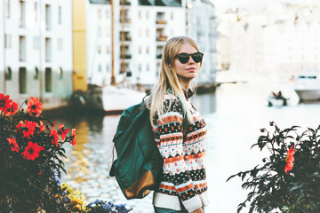 Young woman with backpack sightseeing walk in Alesund city Norway vacations weekend Travel Lifestyle fashion outdoor