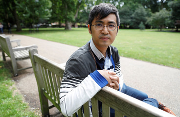 Alex Chow of the Umbrella movement of Hong Kong, poses for a picture in London