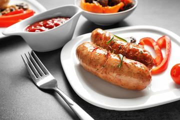 Grilled sausages served on plate with vegetables