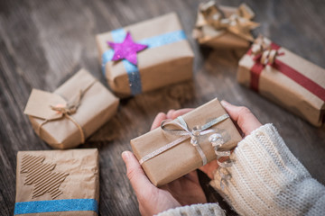 Hands holding beautiful gift box for holiday giving