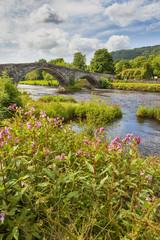 Pont Fawr, medieval bridge and old cottage at Llanrwst