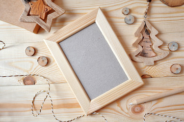 Christmas background with a wooden frame and a star and a Christmas tree. Flat lay, top view photo mockup
