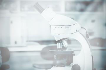 Composite image of microscope in laboratory