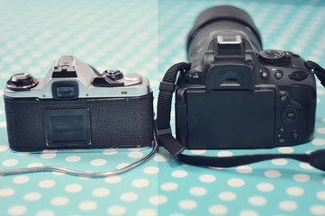 Cameras, old and new.Film camera and digital camera