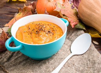 Image of useful soup of pumpkin puree on linen fabric