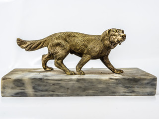 Statuette of a dog made of bronze on a white background