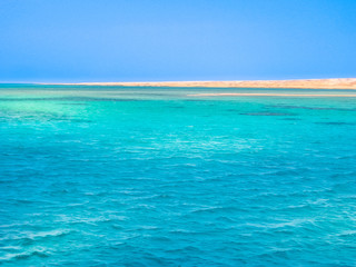 Background of blue sea of Ras Mohammed National Park with its clear and transparent waters and its famous reef in Sharm el Sheik, Sinai Peninsula, Egypt. Copy space.