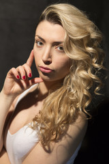 Headshot of a beautiful curly blonde girl