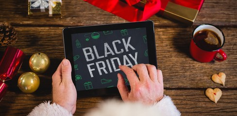Composite image of black friday with green christmas icons