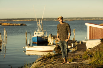 Portrait of man standing in small  fishing harbor