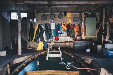 Empty boat and hanging clothes at holiday villa