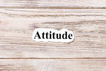 Attitude of the word on paper. concept. Words of Attitude on a wooden background