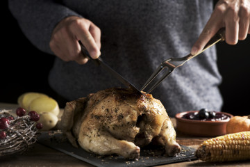 young man carving a roast turkey