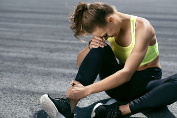 Leg Injury. Woman Suffering From Pain In Leg After Workout
