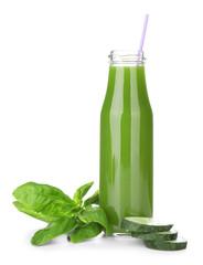 Green vegetable juice in bottle on white background