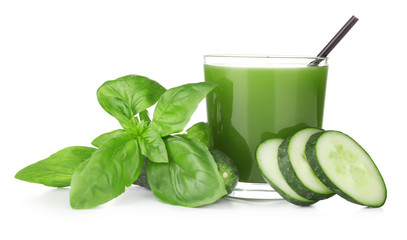 Green vegetable juice in glass on white background