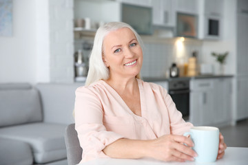 Beautiful mature woman at home