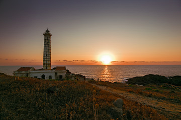Seascape with lighthouse and sunset at sunset on Ustica island in Meditteraneo,