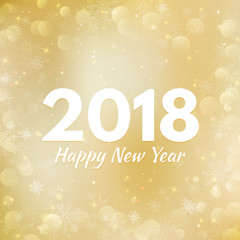 Gold Happy New Year 2018 card, with bokeh, snowflakes and shiny lights
