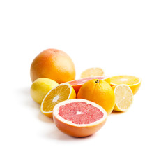 Grapefruits, oranges and lemons on a white background. Isolated..