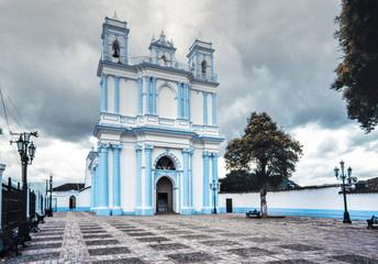 The blue colonial Santa Lucia church. San Cristobal de las Casas, Chiapas, Mexico.