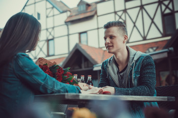 Date of two lovers. Teenagers walk around the city. Couple in love spending time together