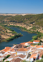 View of Guadiana river bend and residential houses of Mertola city on the ripe. Mertola. Portugal