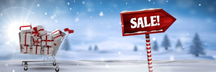 Sale text and gifts in trolley with Wooden signpost in Christmas