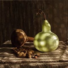 Still life with two pumkins and nuts with shadows