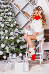 Portrait of beautiful girl blonde with a gift Christmas tree ornaments.Celebration and happiness. merry Christmas. The emotions of a person