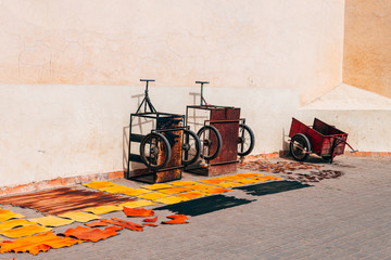 leather slices drying out at marrakech street, morocco