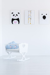 White cradle with cloud pillow