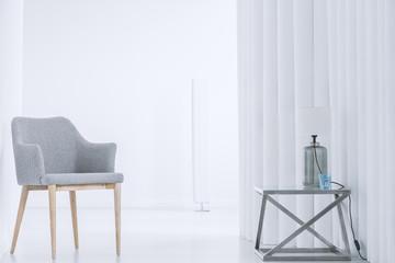 Grey chair in white interior