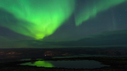 Aurora in the sky and the reflection in the water.